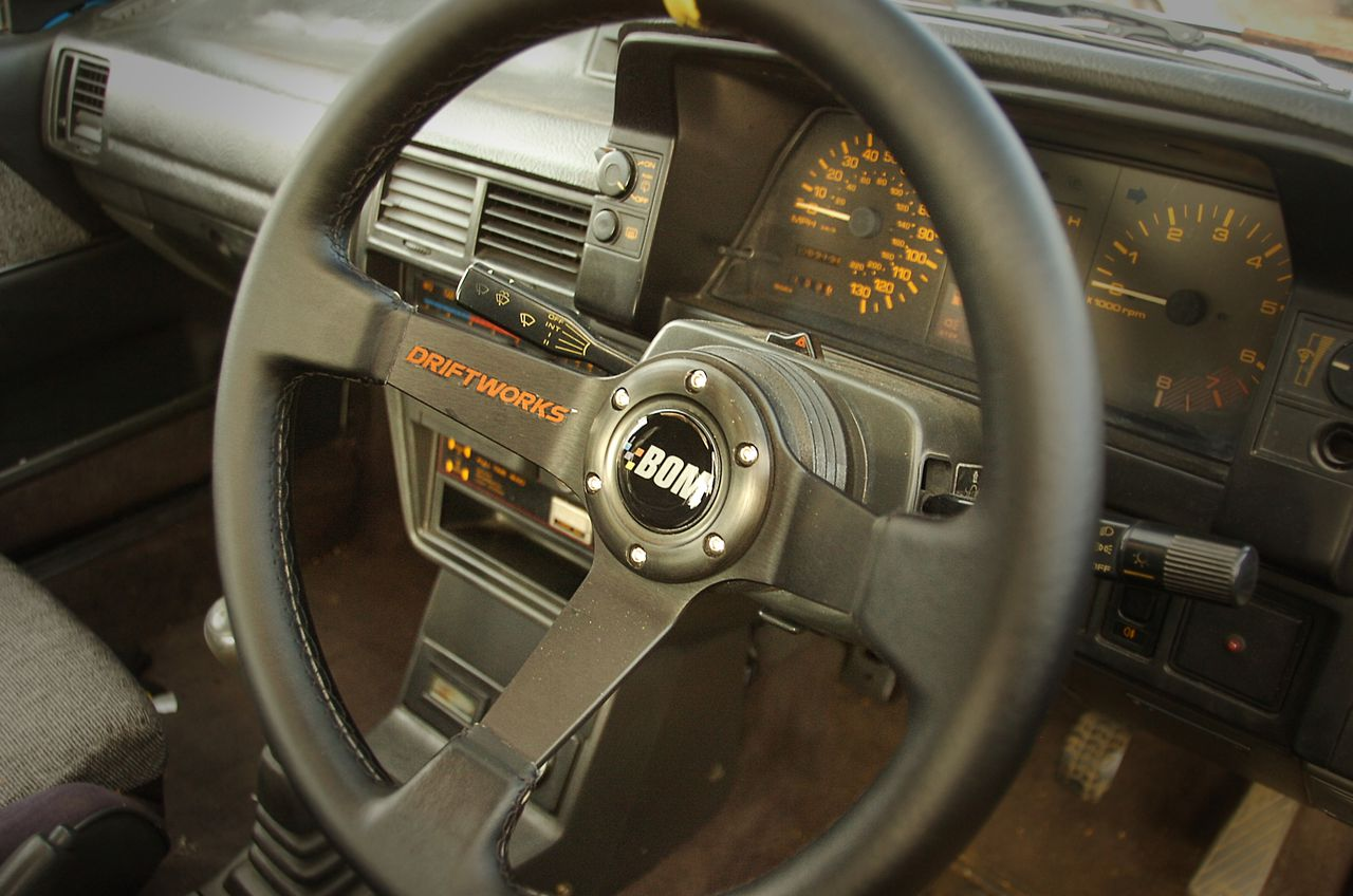 Bad Obsession Motorsport horn push sticker on Driftworks steering wheel