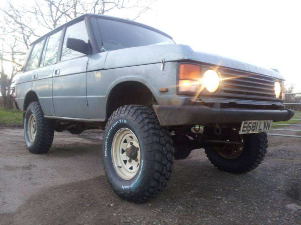 The photo is actually an extremely lifted 1987 Range Rover.
