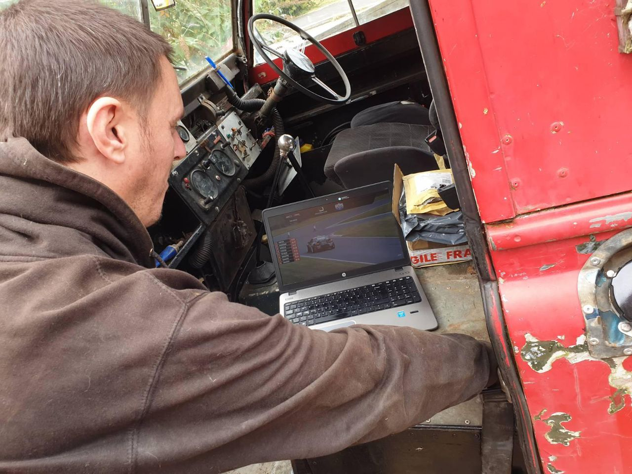 Me, watching a British Drift Championship livestream while working on the Land Rover.