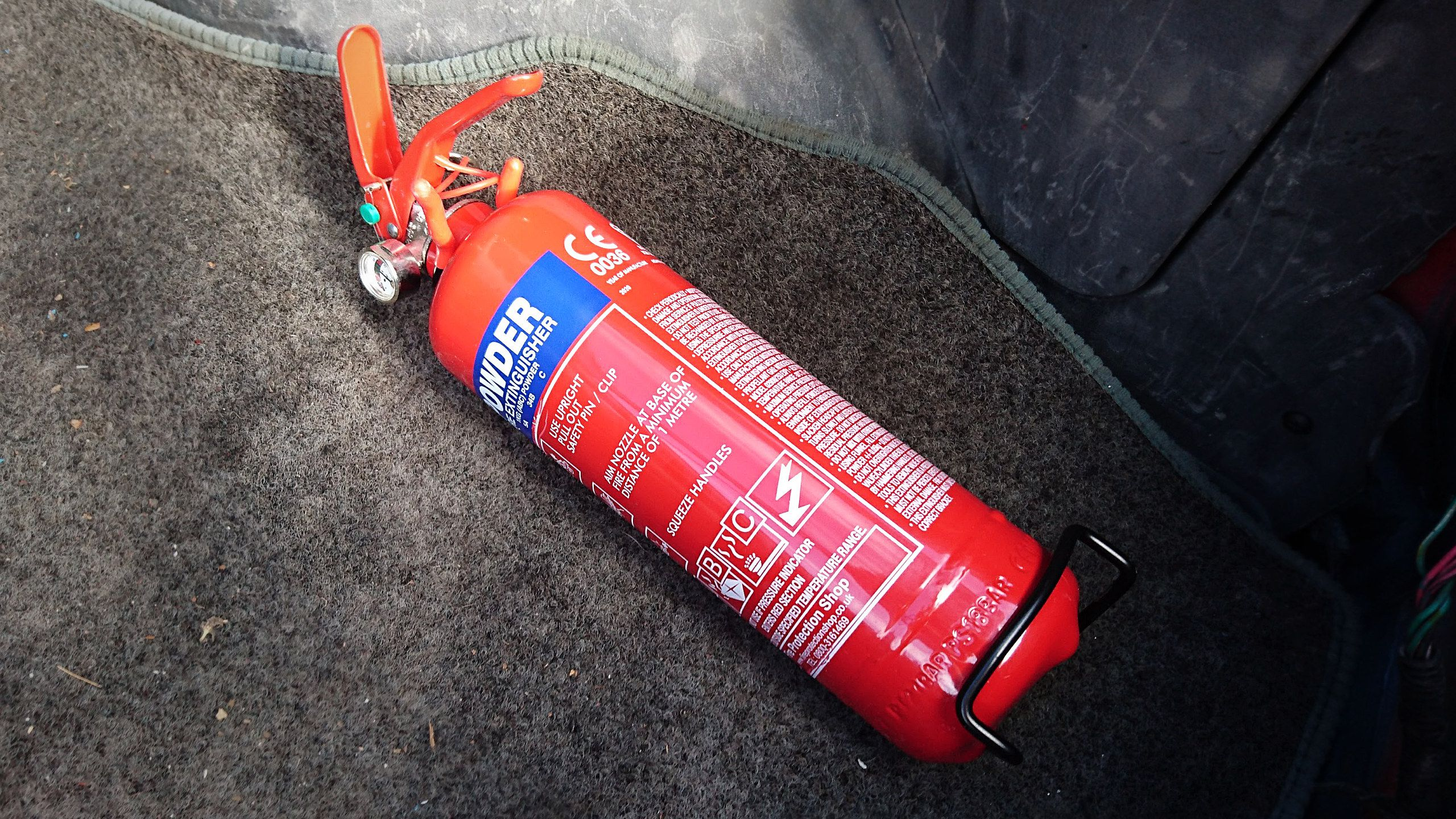 Fire extinguisher fitted in the boot