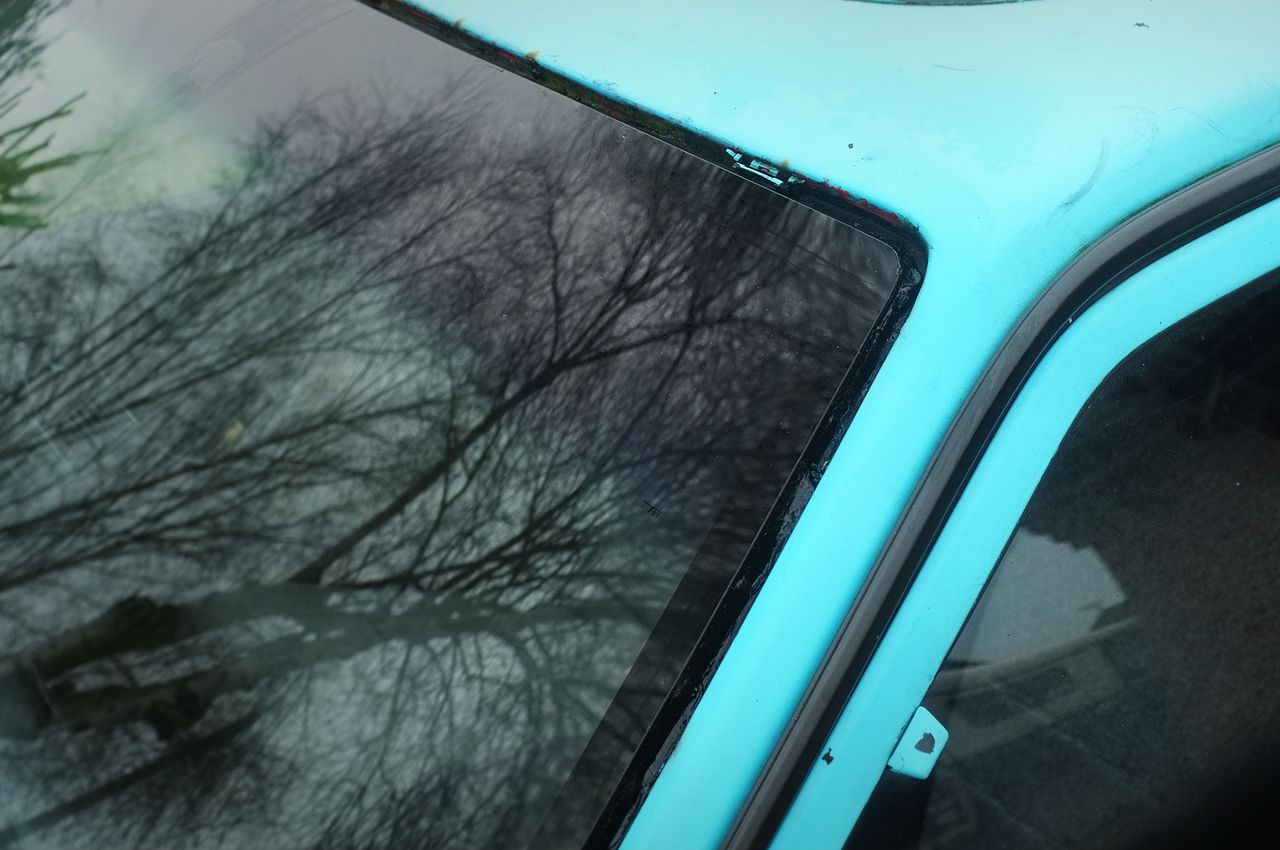 New Mazda 323 BF windscreen, with blue tint