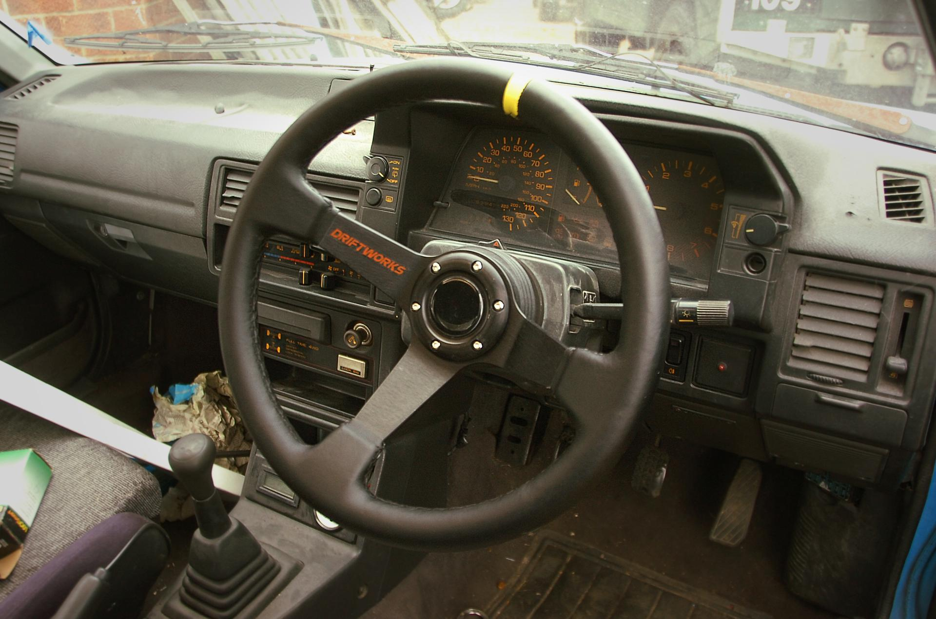 Driftworks leather steering wheel in Mazda 323 GTX interior